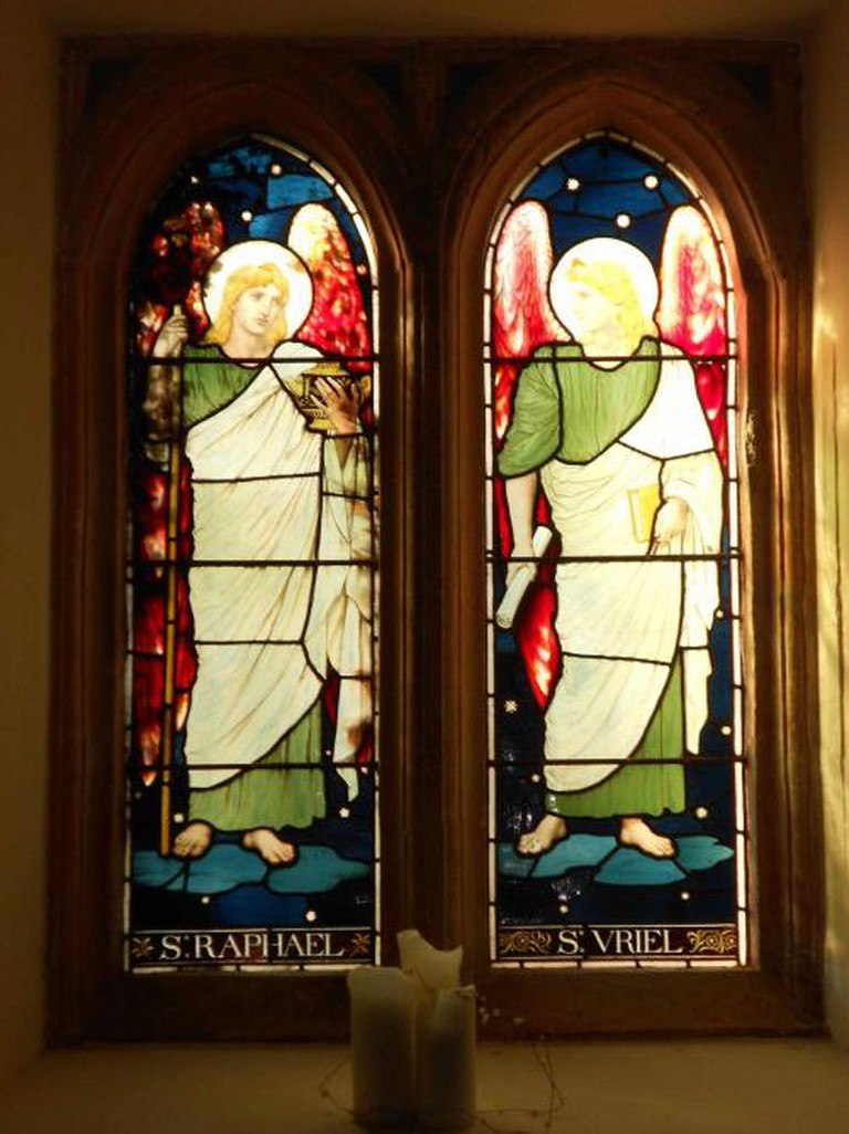 Stained glass windows by Henry Holiday depicting Raphael and Uriel in St Michael and All Angels Muncaster