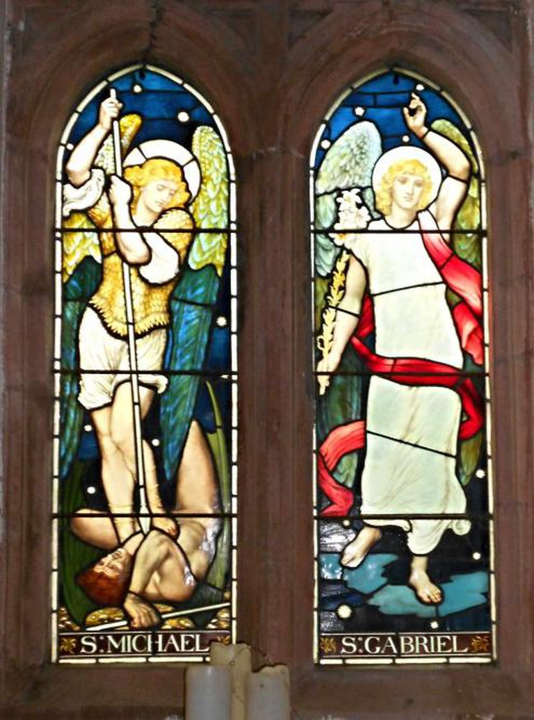 Stained glass windows by Henry Holiday depicting Michael and Gabriel in St Michael and All Angels Muncaster