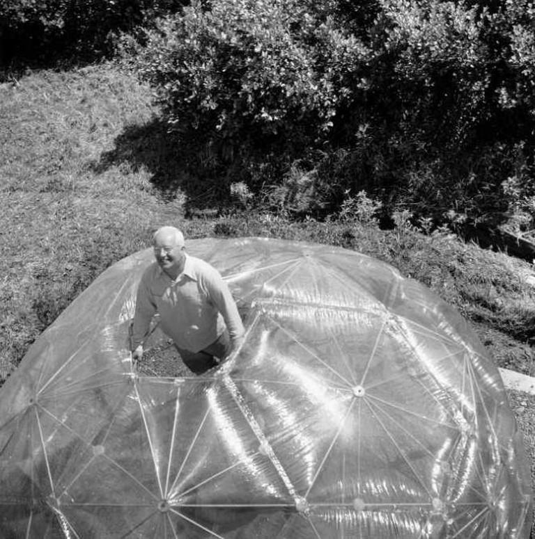 Hazel Larsen Archer, Buckminster Fuller inside His Geodesic Dome, 1949, gelatin silver print, 9 ½ x 9 ¼ inches. Estate of Hazel Larsen Archer and Black Mountain College Museum and Arts Center.