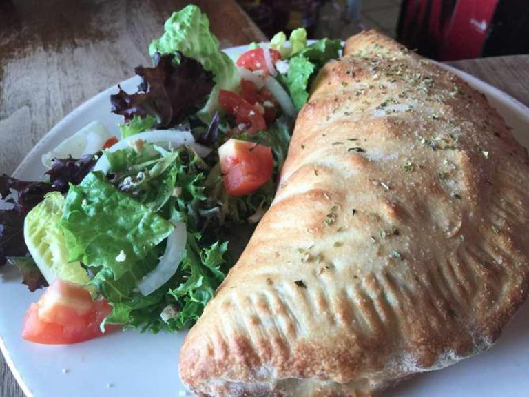 Can you handle a calzone from Dempsey's? | Courtesy of Dempsey's Brewery Pub & Restaurant