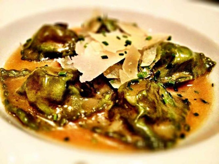 The spinach ravioli dish is filled with roasted veal, proscuitto and pistachio Mortadella.