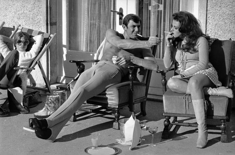 Stripped to the waist, Australian actor George Lazenby offers co-star Helena Ronee a light, whilst filming the new James Bond film 'On Her Majesty's Secret Service' in the Swiss Alps   Courtesy of Everyman Theatre and Getty Images.