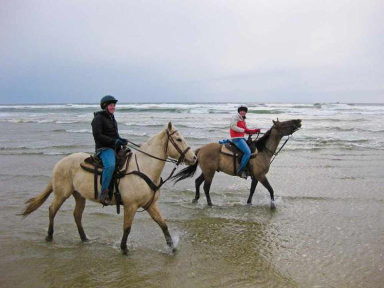 Horseback riding on beach   © Jeremy Wilburn/Flickr