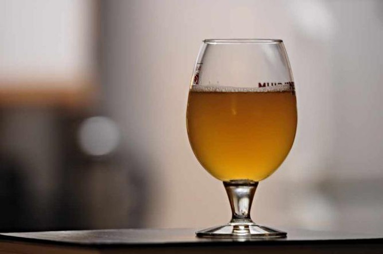 An ever-changing list of craft beers are served at Noble Hops like the spiked Saison above.
