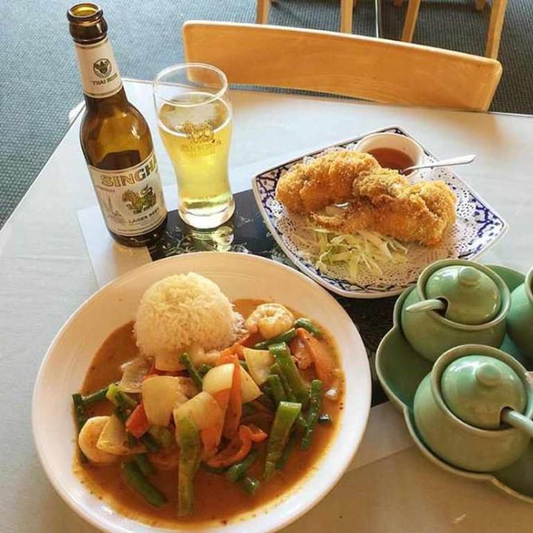 Pad Prikkhing and angel wings | Courtesy of Heidi Licata, Krua Thai Cafe