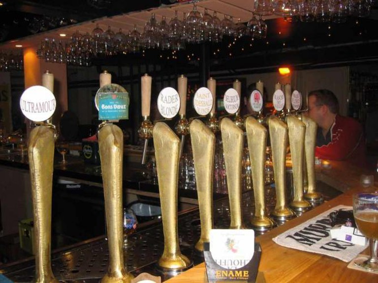 a bar with nine different draught beer levers