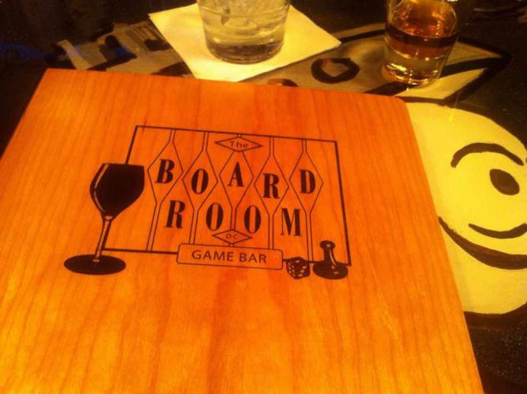 menu for Board Room, the logo in the shape of a backgammon board with a wine glass, a die, and a Sorry! piece