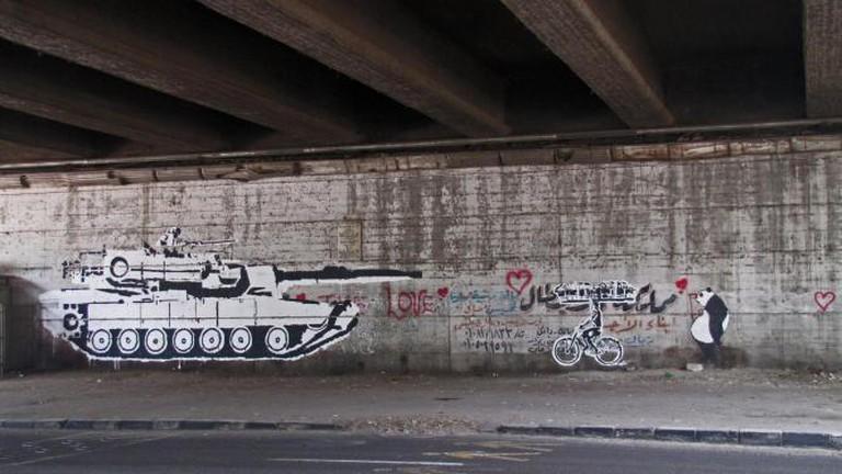 Tank vs Biker | © Ganzeer