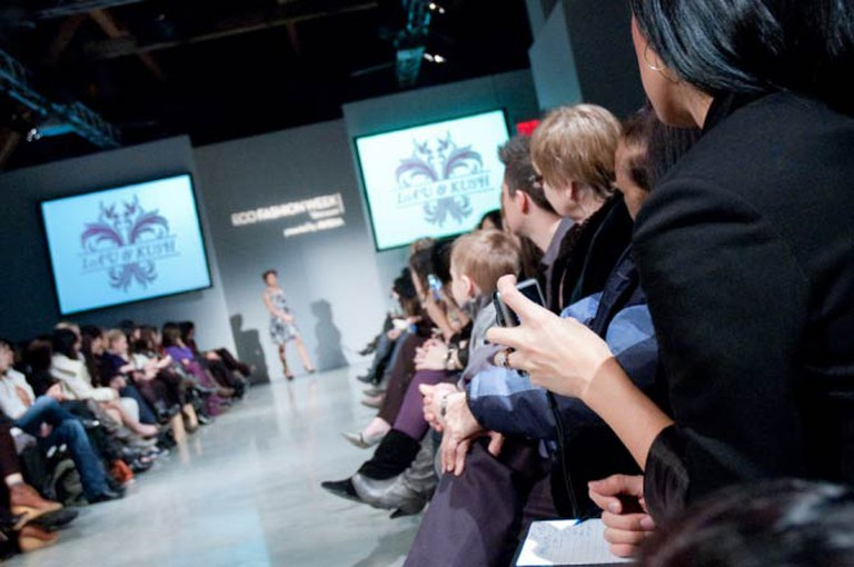 The crowd watches a model walk down the runway at Aveda Eco Fashion Week in Vancouver, Canada | © Jason Hargrove/Flickr