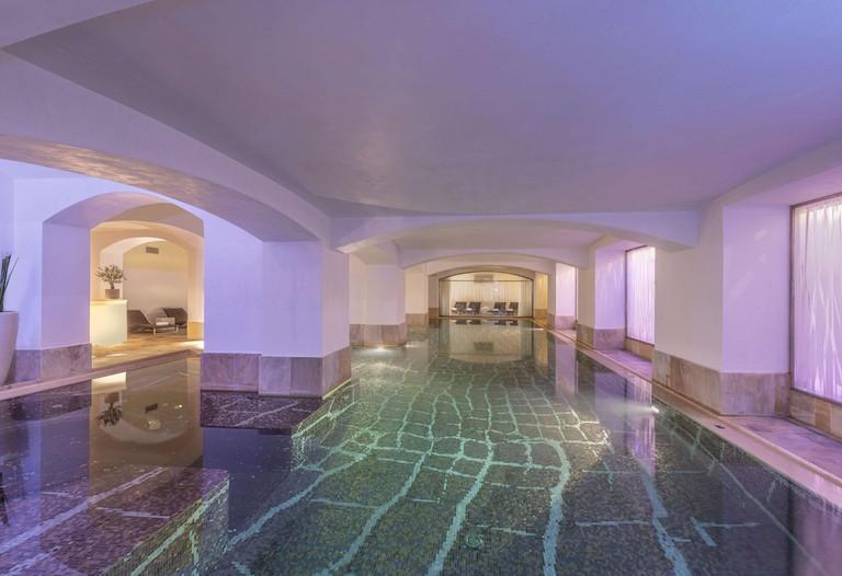 Rooms mix Roman Classicism with mid-century Italian design