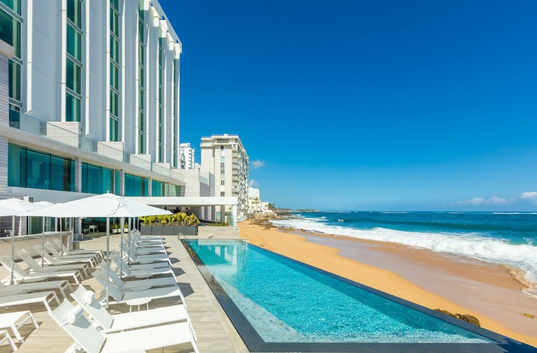 Modern white and blue eating area at Condado ocean club with views of the beach and ocean