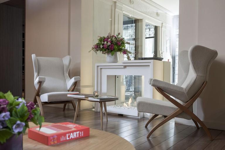 Enjoy soothing neutral tones in the Hôtel de Nell's bedrooms