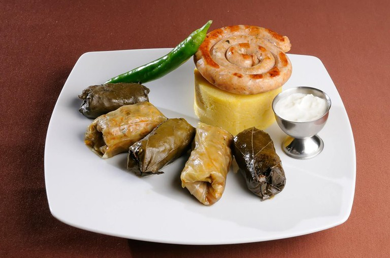 Mamaliga and Sarmale with Spicy Sausage and Sour Cream