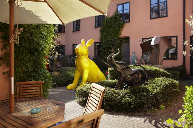 Galleri GKM garden with sculptures by Arman, William Sweetlove, Jan Desmarets and Reinhoud | Photo by Johan Kalén Fotograf