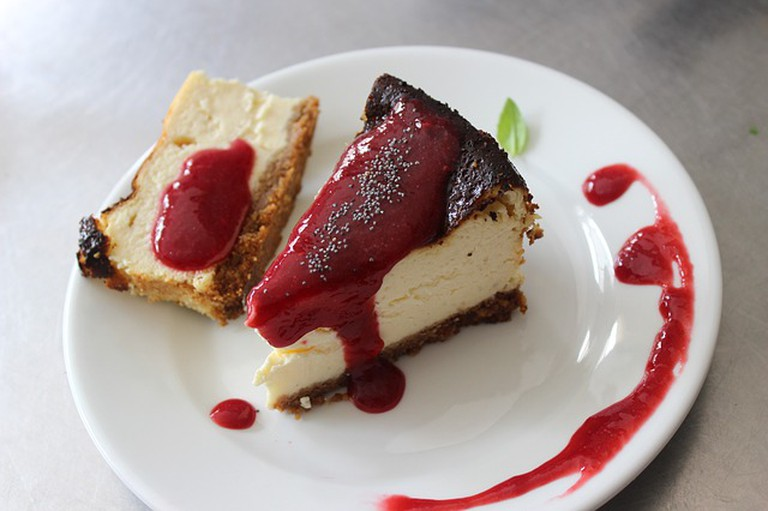 Cheesecake topped with raspberry sauce