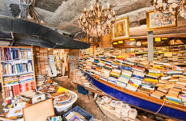 Old books of Acqua Alta bookstore. This is one of the most famous used bookstore in the world © GagliardiImages / Shutterstock