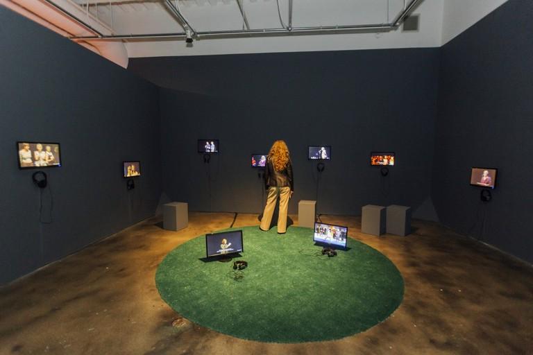 Rimini Protokoll (Helgard Kim Haug, Stefan Kaegi, Daniel Wetzel), 100% City, 2008-16, HD video, Installation view at Museum of Contemporary Art Santa Barbara, 2017, Video concept & realization by Marc Jungreithmeier, Courtesy the Artists. Photo: Brett Bollier