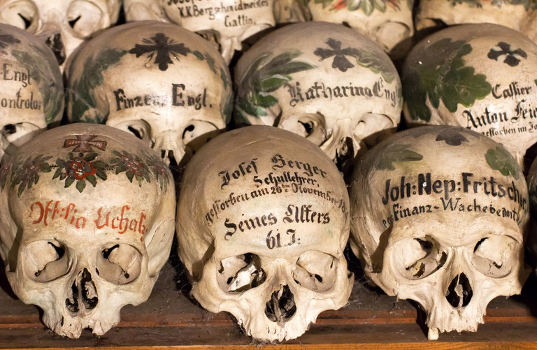 Decorated Skulls in a Bone House of Hallstatt, Austria | © corlaffra/Shutterstock