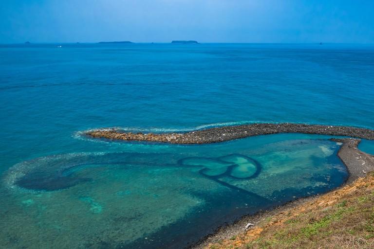 Double-Heart of Stacked Stones, Penghu, Taiwan   © By Ryu K/Shutterstock