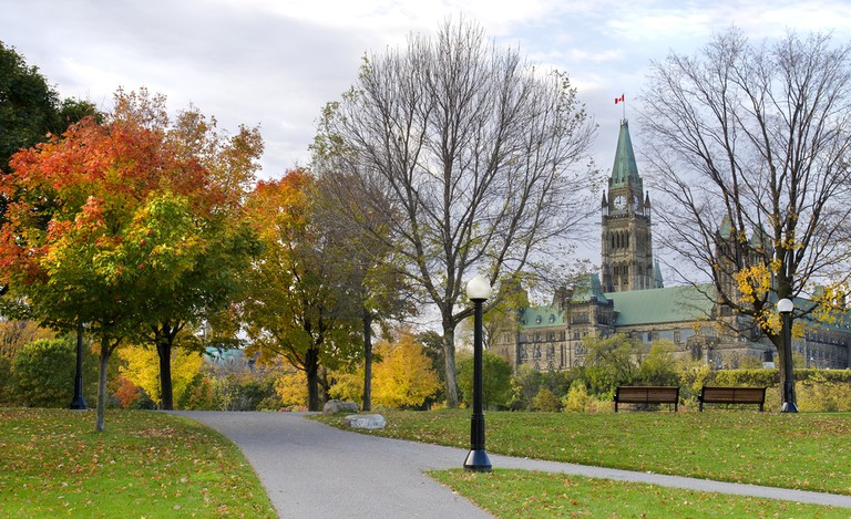 The Canadian Parliament seen from Major's Hill Park in Ottawa during autumn © Mike Loiselle / Shutterstock