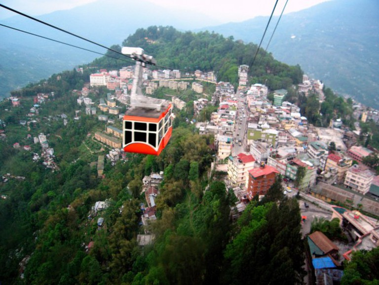 Ropeway Car Travelling Over Gangtok City (C) Flickr/Kalyan Neelamraju
