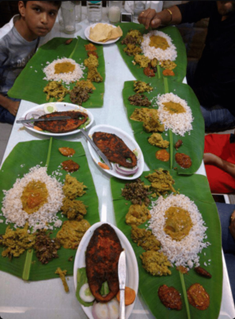 Table of food at Fountain Plaza, Fort. Image Courtesy: Zomato