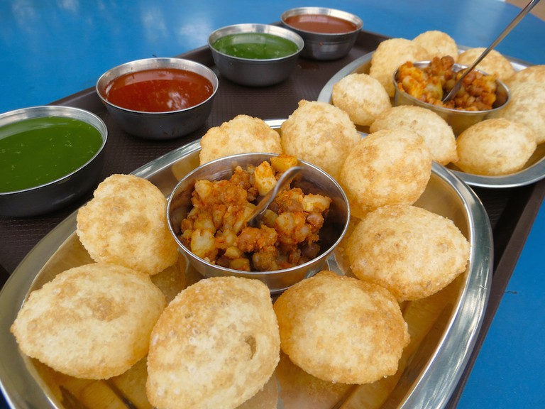 Try out their Pani Puri (crispy hollow shells with chickpeas, potatoes and tamarind chutney served with tangy spicy water) © Apoorva Jinka / Flickr