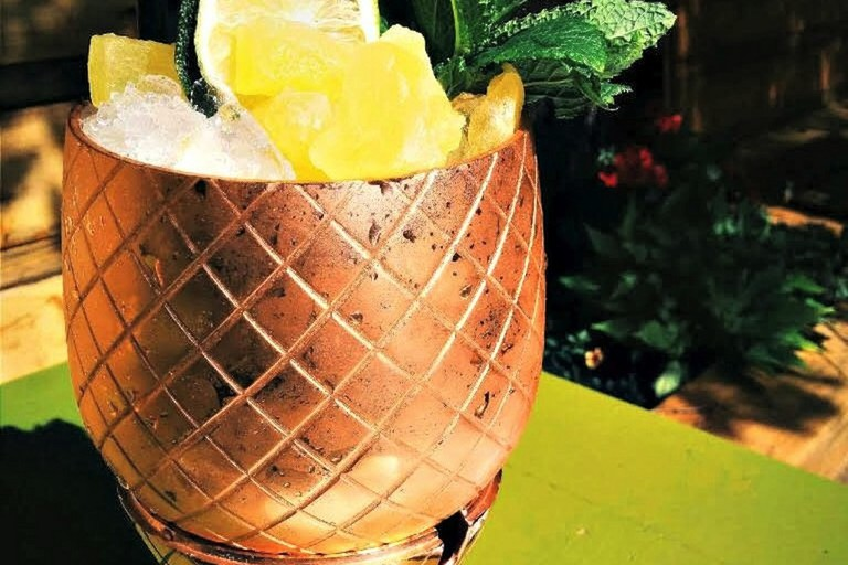 The famous 'Punch for Two' served in a copper pineapple tumbler from The Harbord Room
