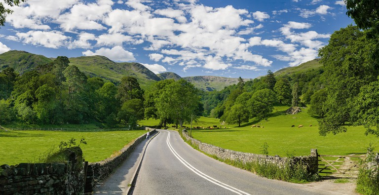 Road Passing Through The Lake District National Park Countryside
