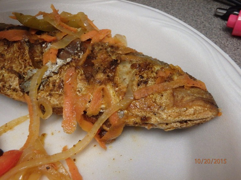 Fried Fish served with Pikliz, a traditional Haitian dish that has been adopted by the residents of Miami