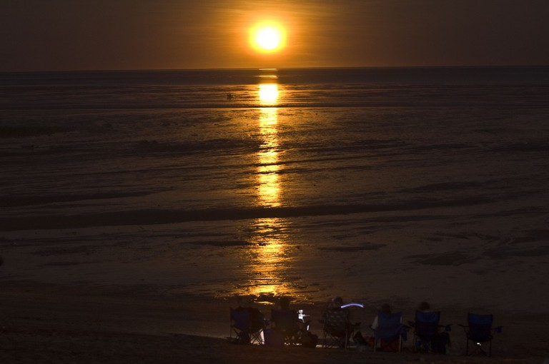 Holiday makers on Town Beach watching the Staircase to the Moon phenomenon, across Roebuck Bay, Broome | Courtesy of Tourism Western Australia