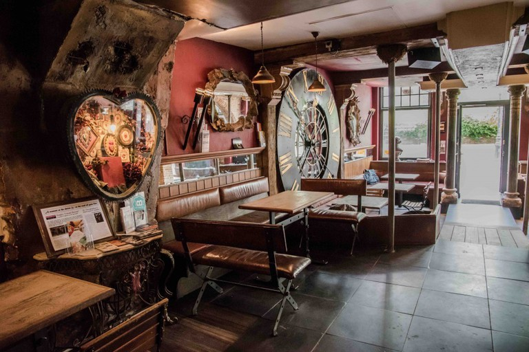 One of St. Christopher's main assets is its downstairs bar with many Belgian beers and an eclectic, warm style | Courtesy of St. Christopher's