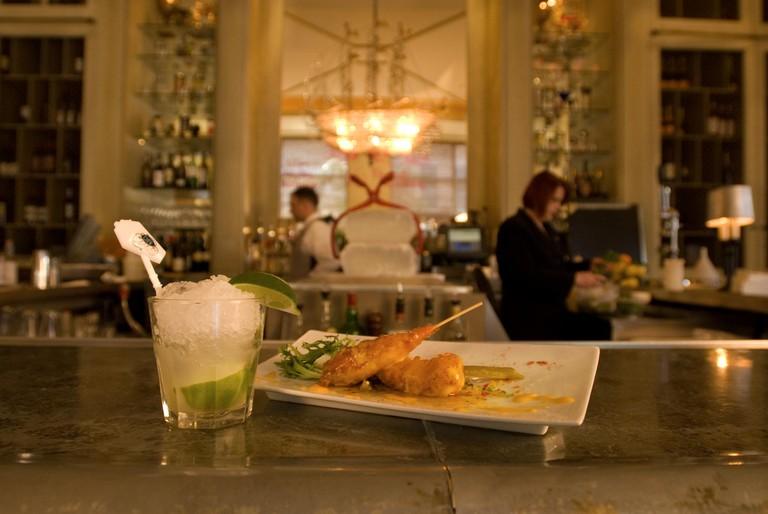 Shrimp appetizer and vodka tonic cocktail at Café Adelaide & the Swizzle Stick Bar