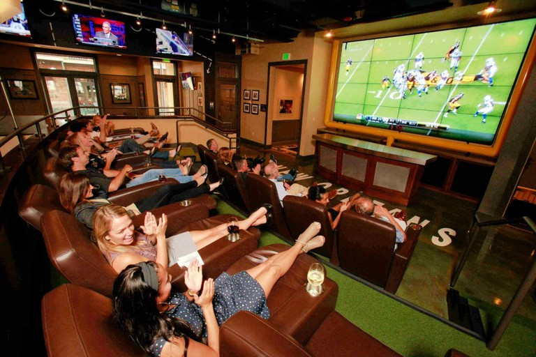 Leather recliners in front of a 13-foot mega screen at Manning's, courtesy of Manning's.