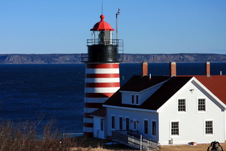 One of the most photographed lighthouses in #Maine - Quoddy Head | © Dana Moos/Flickr