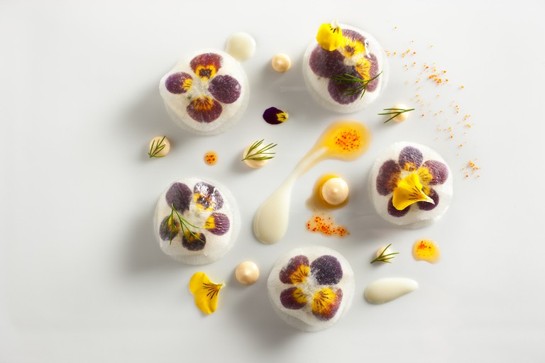 Peekytoe Crab with Pickled Daikon Radish and Violas prepared by Daniel Humm, Executive Chef of Eleven Madison Park in NYC