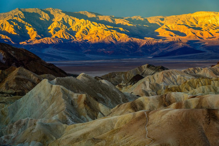 Morning Colors, Sunrise at Zabriskie Point in Death Valley National Park lights up the Panamint Range on the horizon | © Rick Bergstrom/Flickr