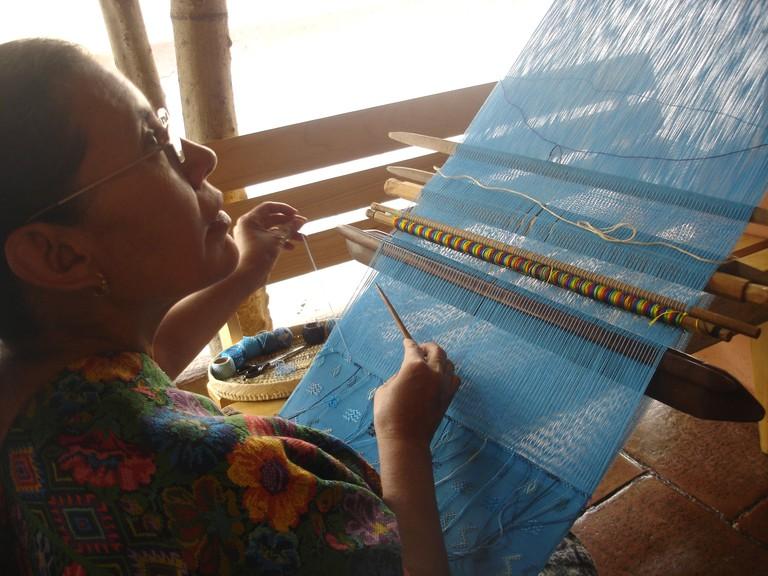 An artisan creating a traditional huipil   © David Amsler/Flickr
