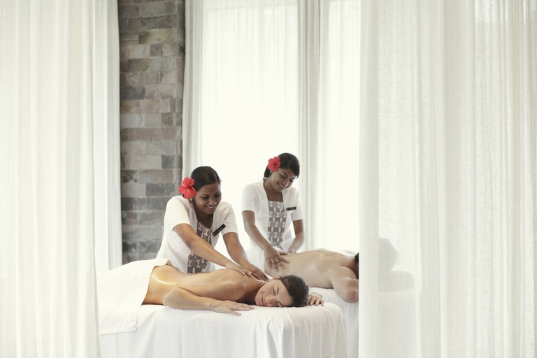 Couples massage in Fiji | Courtesy of InterContinental Fiji Golf Resort and Spa / Flickr