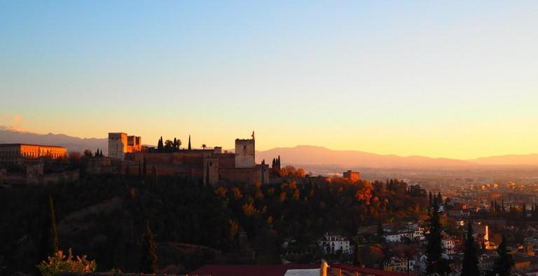 Sunset over Granada as seen from Albaicin´s Plaza San Nicolas; courtesy of Encarni Novillo