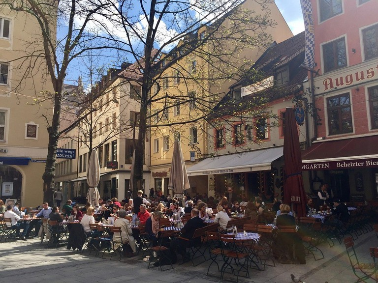 Past the terrace before the yellow building you'll find Munich's cheapest draft beer © Roanna Mottershead