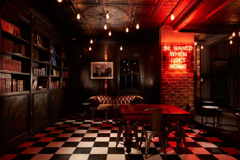 Think 1920's New York speakeasy glamour, rock 'n roll, meat, and craft beer