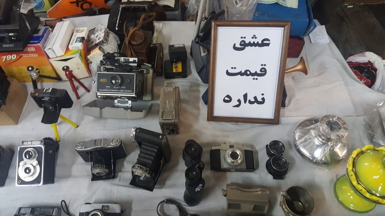 "A vintage camera dealer's sign says ""You can't put a price on love"" 