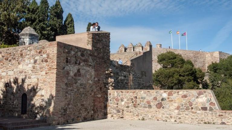 "<a href=""https://www.flickr.com/photos/pollobarca/"">The turrets of Málaga's Gibralfaro castle | © Paul Barker Hemings/Flickr</a>"