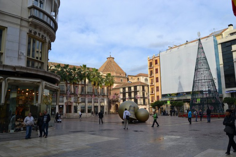 "<a href=""https://www.flickr.com/photos/emijrp/"" target=""_blank"" rel=""noopener noreferrer"">Plaza de la Constitución is at the heart of Malaga's old town 