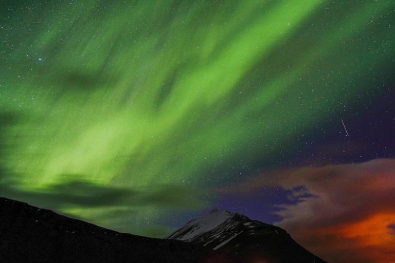 Northern Lights over Reykjavik | © Tom Withnall/Flickr