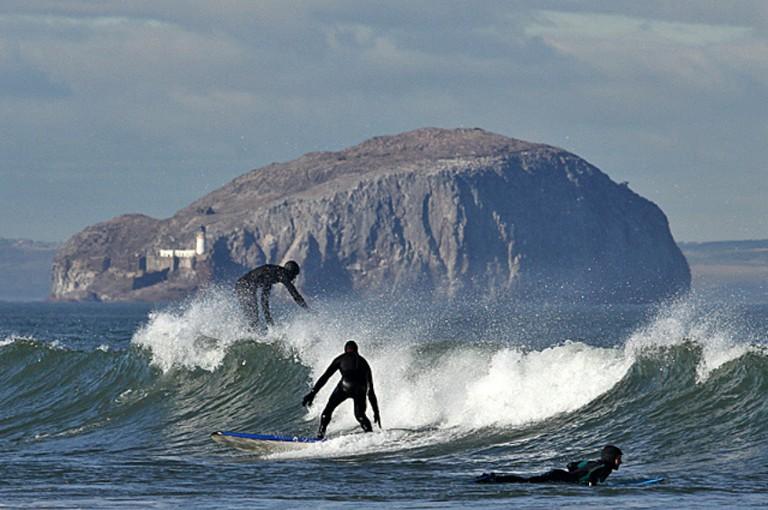 Surfing In Belhaven Bay | © Walter Baxter/Geograph