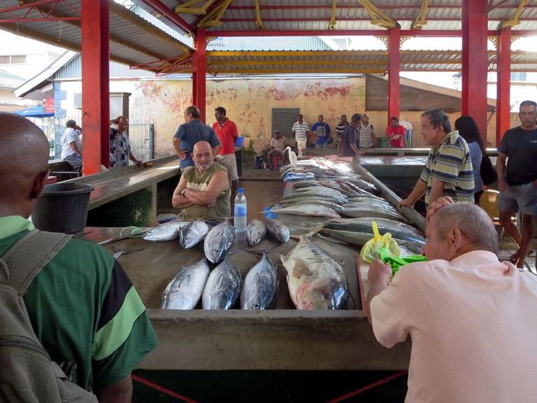 Fish mongers in the Sir Selwyn-Clarke Market in Victoria, Seychelles.