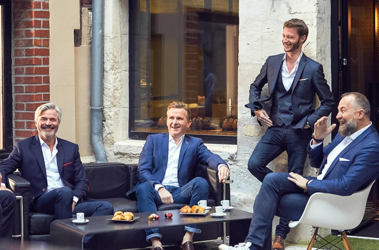 Gentlemen in suits wearing l'Atelier 5 designs