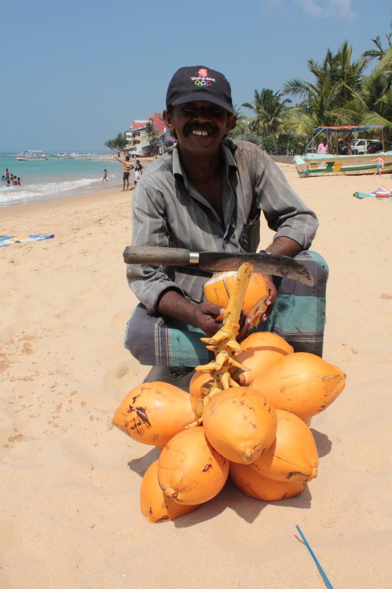 King Coconut Seller, Hikkaduwa Beach © Melissa / Flickr